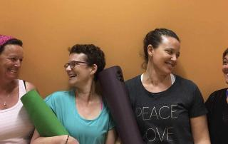 women with getting ready for a yoga class in Brisbane