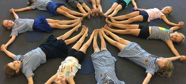Kids yoga at Holland Park State School